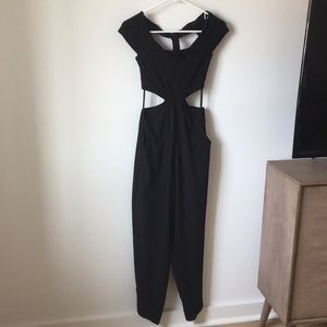 Bebe Black Jumpsuit with side cut outs